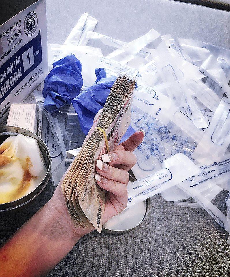 Vietnamese gold digger showing off Vietnamese dongs