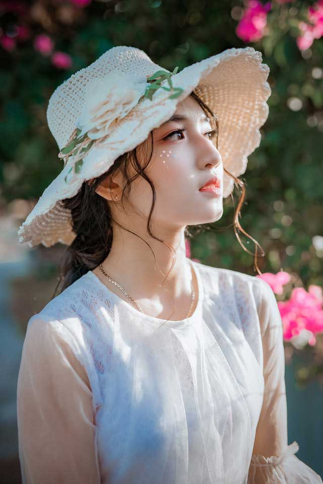 Vietnamese girl wearing a hat
