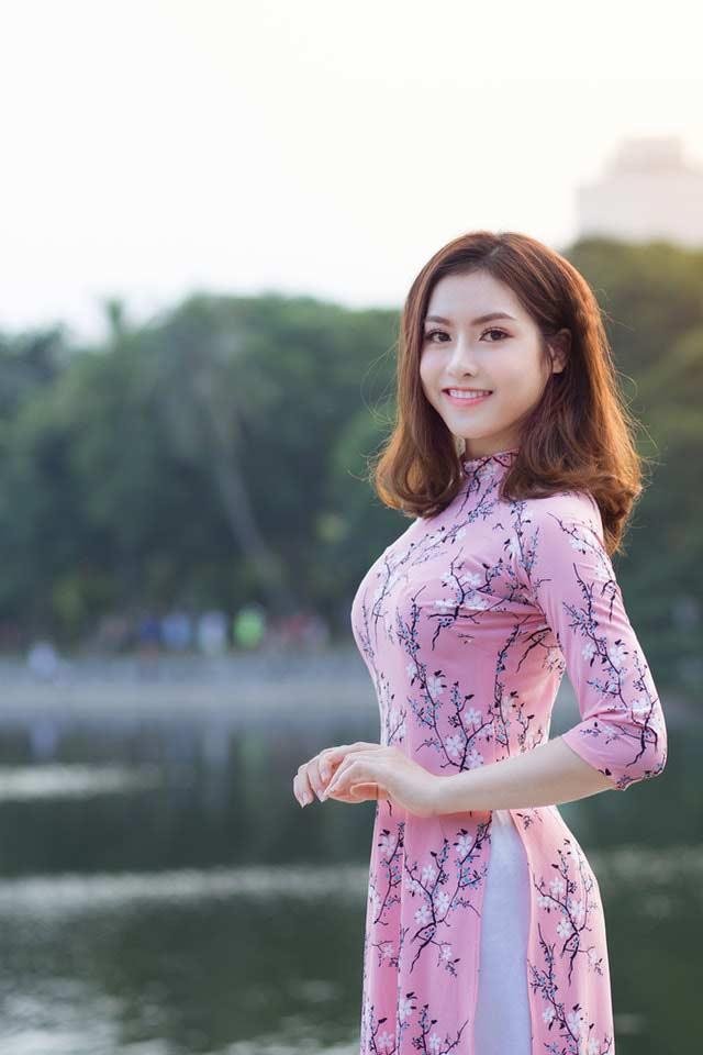 best dating app in vietnam: beautiful Vietnamese girl in pink ao dai