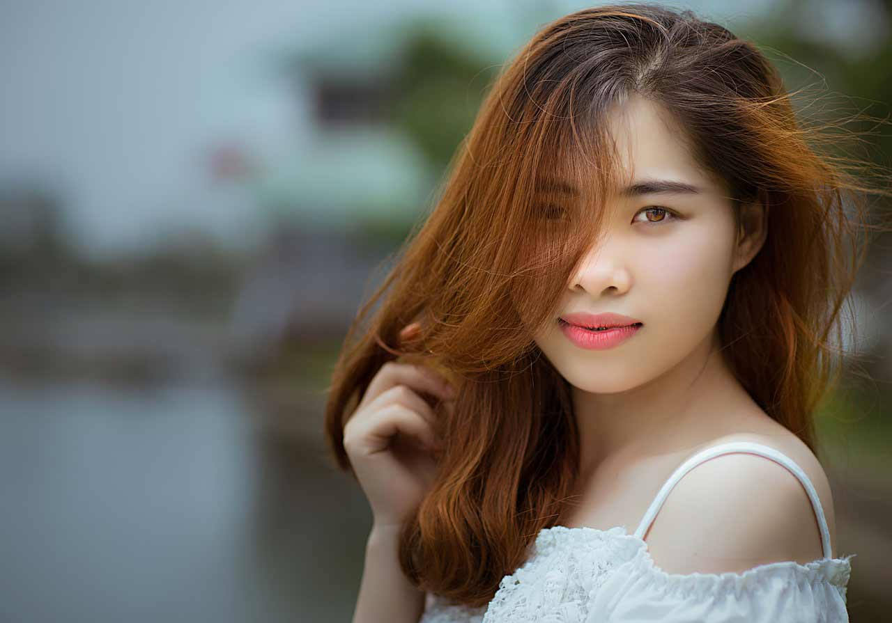 beautiful Vietnamese girl with dyed hair