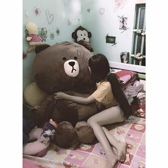 Vietnamese girl with a giant teddy bear