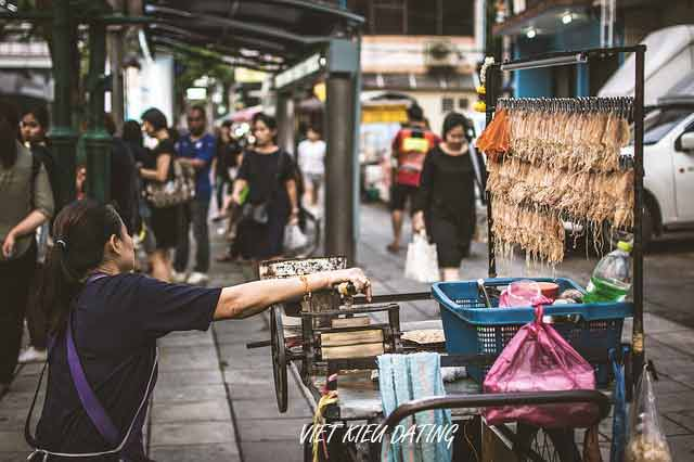 woman selling squid