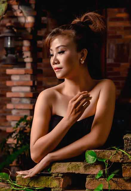 Vietnamese cougar in a black dress