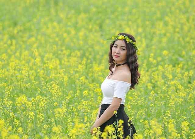 Vietnamese woman in a garden of flowers
