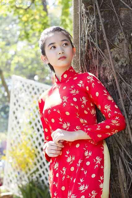 Vietnamese girl in red áo dài dress