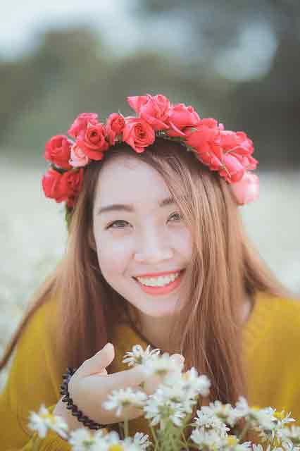Displays of affection in Vietnam: Vietnamese girl in yellow dress smiling
