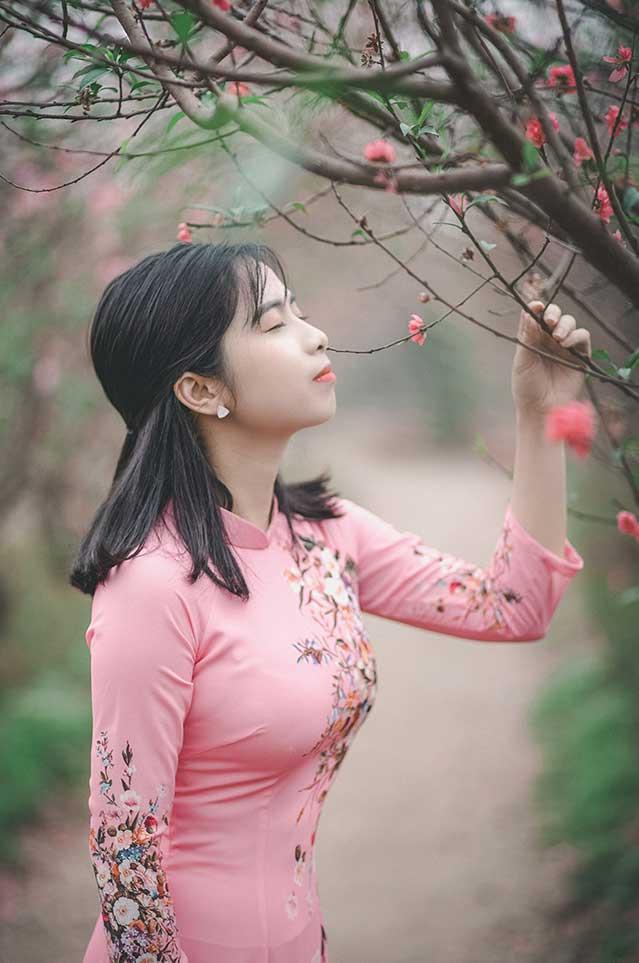 Vietnamese girl wearing pink ao dai dress