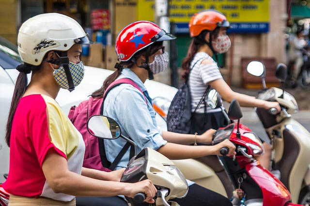 Where to stay in ho chi minh city: girls on scooter