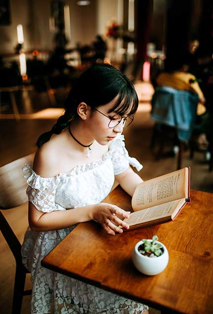 Vietnamese girl reading a book