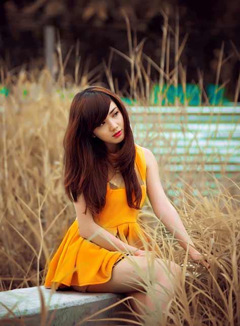 Vietnamese girl wearing yellow dress