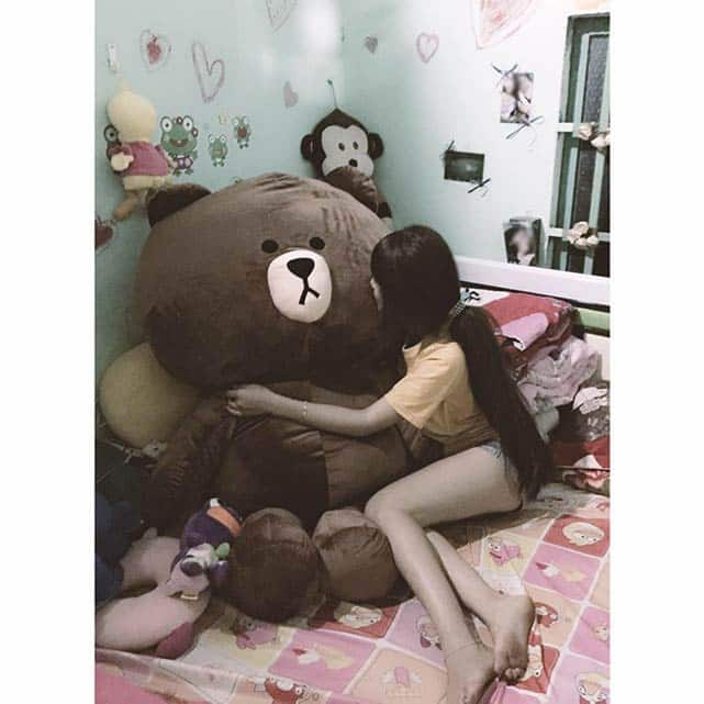 Vietnamese girl with a giant teddy bear