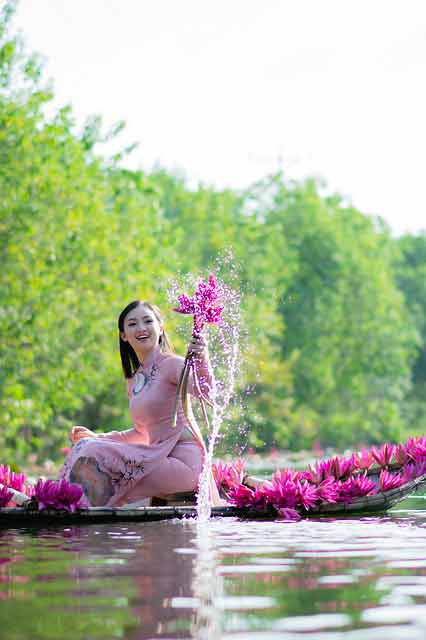 Vietnamese girl with flowers in her hand