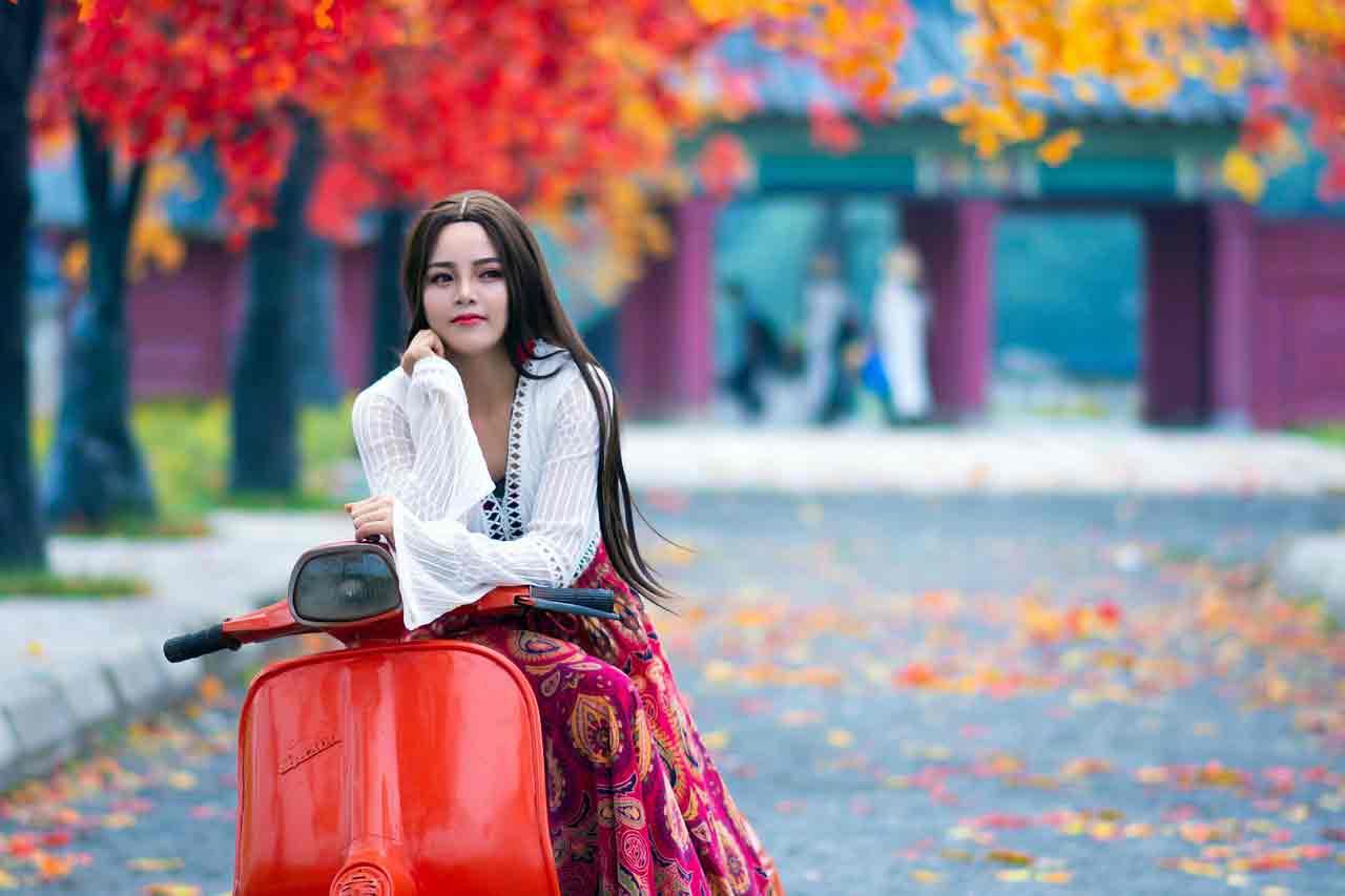 Vietnamese girl on red motorbike