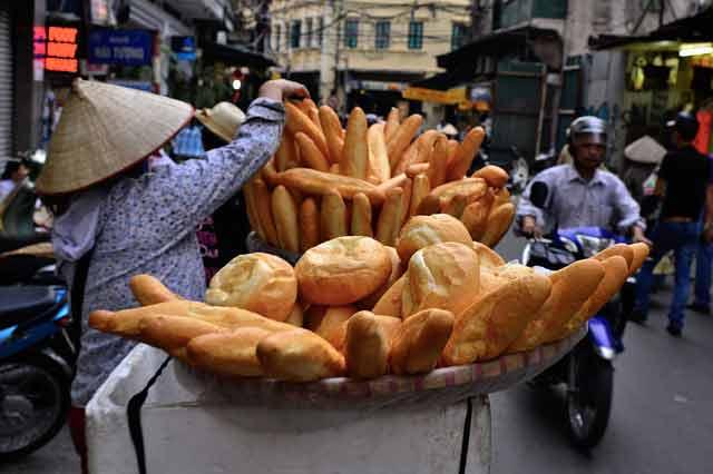 Vietnamese woman selling bread