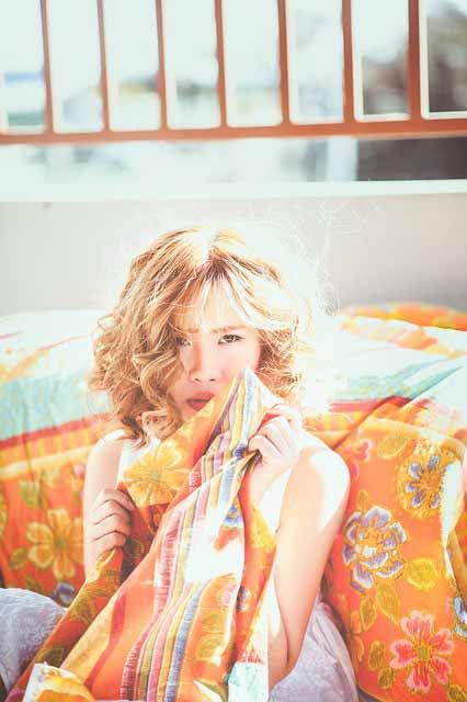 girl holding a blanket