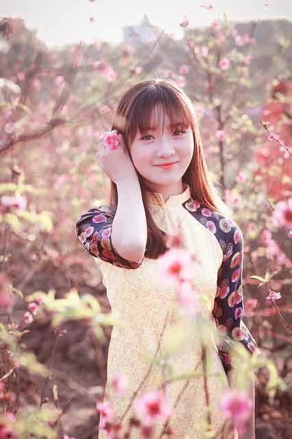 Vietnamese girl in black and yellow dress