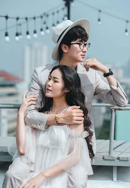 Guy holding a girl