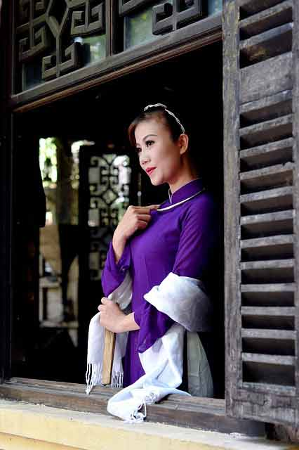 Vietnamese cougar in a purple ao dai dress