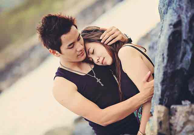 Displays of affection in Vietnam: Asian couple embracing