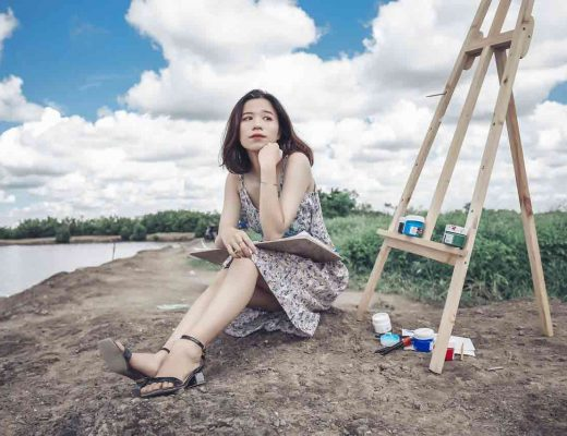 Vietnamese girl thinking while sitting down